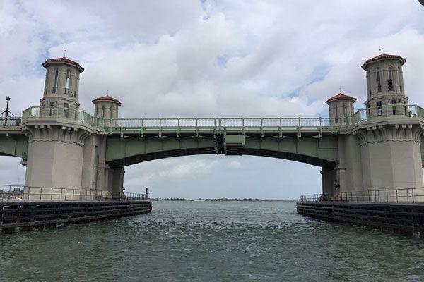 Pass under the famous bridge of lions